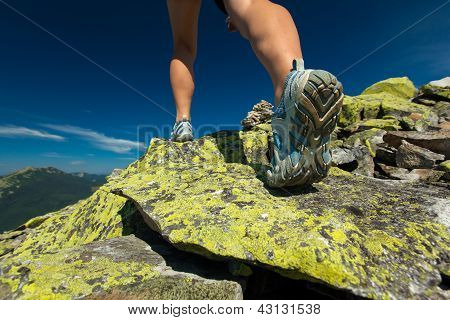 Hiker Jumps Over Stones In Carpathian Mountains With Foot Closeup