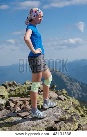 Woman With Bandage On Knees Stands At The Stone Outdoor