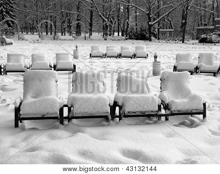 Rows Of Snow-covered Park-chairs