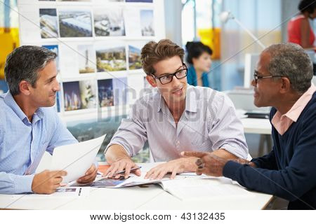 Group Of Men Meeting In Creative Office