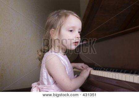 Preschooler At Piano