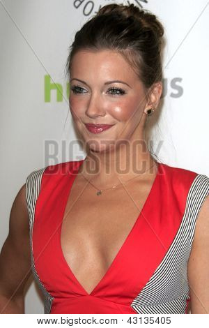 "LOS ANGELES - MAR 9:  Katie Cassidy arrives at the  ""Arrow"" PaleyFEST Event at the Saban Theater on March 9, 2013 in Los Angeles, CA"