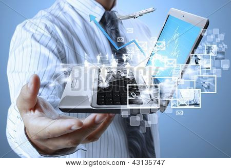 Businessman with laptop in his hands
