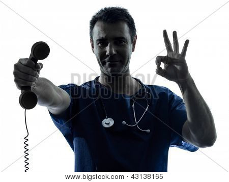 one caucasian man doctor surgeon medical worker  holding phone gesture silhouette isolated on white background