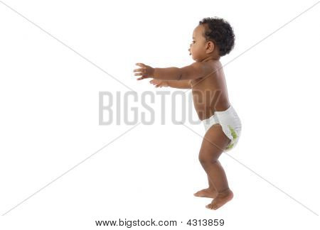 African Baby With Diaper Learning To Walk