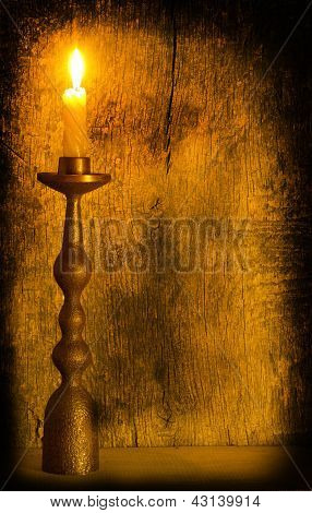 A Burning Candle In A Candlestick