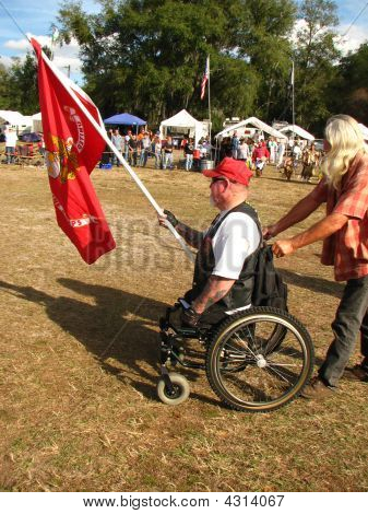 Man Carrying Marine Flag