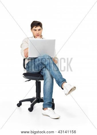 Man Working On Laptop Sits On The Chair