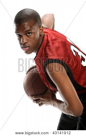 Young black basketball player with ball isolated on a white background