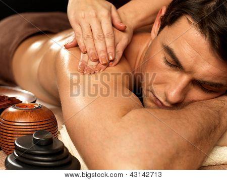 Man Having Massage In The Spa Salon