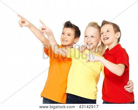 Happy Children Point By Finger On Something Away.
