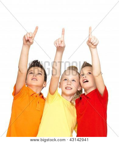Portrait Of The Happy Children Point Up  By Finger - Isolated On White