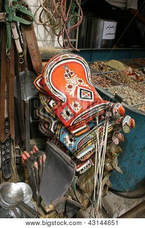 Colorful donkey saddles for sale in a Chinese market