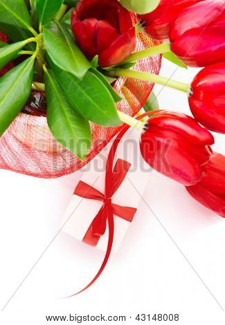 Photo of festive border, red fresh tulips bouquet in the pot, small white gift box with red ribbon, isolated on white background, home decoration, floral bunch for mothers day, romantic holiday