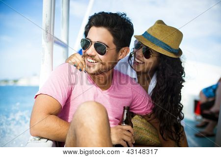 Happy couple enjoying vacations on the beach