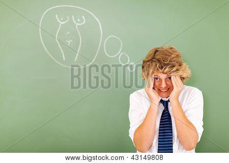 shy high school boy feeling embarrassed when thinking about female body