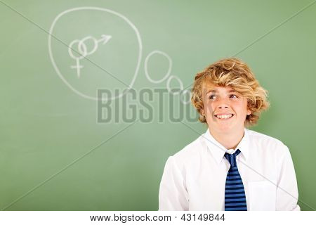cute high school student daydreaming about sex in classroom