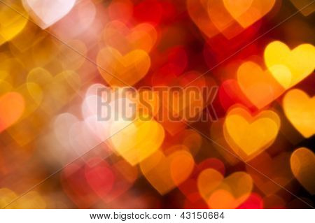 red and golden hearts background