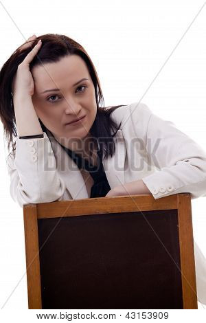 Close Up Portrait Of A Secretary On A Chair Isolated Over White