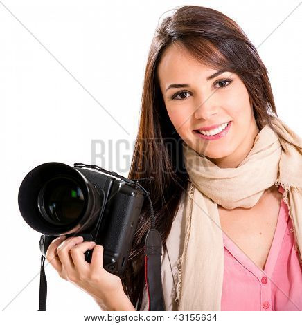 Female photographer holding a camera and smiling - isolated over white