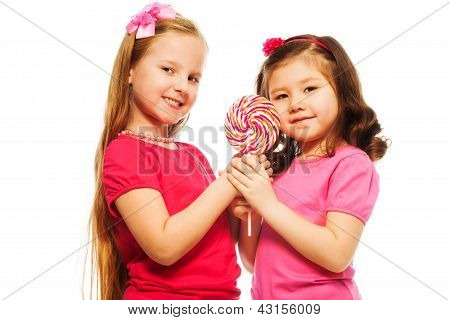 Two Girls With Lollipop