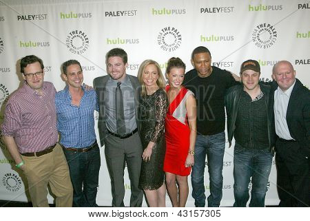 """BEVERLY HILLS - MARCH 9: The cast and crew of """"ARROW"""" arrives at the 2013 Paleyfest """"Arrow"""" panel on March 9, 2013 at the Saban Theater in Beverly Hills, CA."""