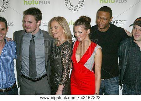 """BEVERLY HILLS - MARCH 9: The cast of """"ARROW"""" arrives at the 2013 Paleyfest """"Arrow"""" panel on March 9, 2013 at the Saban Theater in Beverly Hills, CA."""