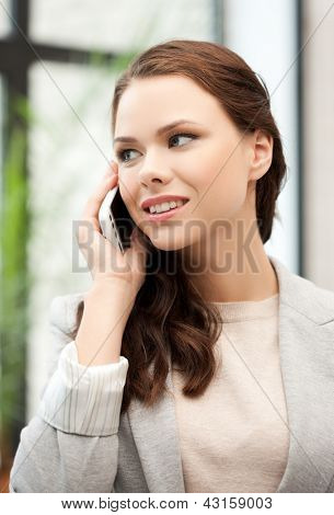 picture of businesswoman with cell phone calling or talking