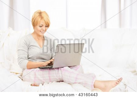 bright picture of happy woman with laptop computer.
