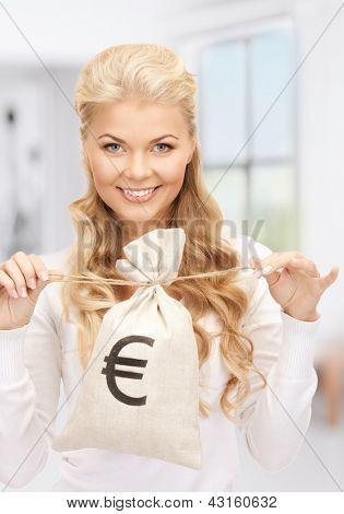Foto de mulher com euro assinado saco