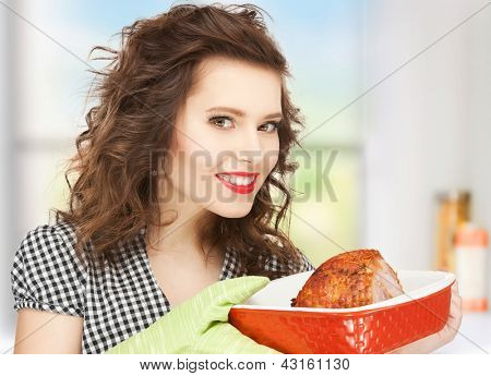 picture of perfect housewife serving dish with meat