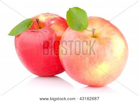 Two Juicy Red Apples With Leaves And Drops Of Water Isolated On A White Background