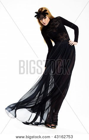 Celebration. Classy Woman Dancing In Long Black Dress And Mask. Vintage Style