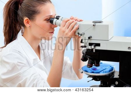 Girl student in a university laboratory cytological