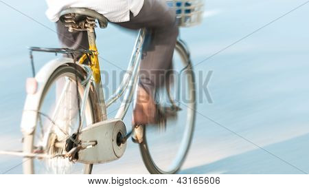 Bicycle with person in motion in Vietnam, Asia.