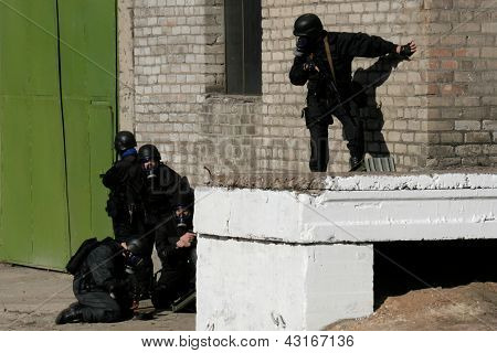 Anti-terrorist Police During A Black Tactical Exercises  Real Situation.