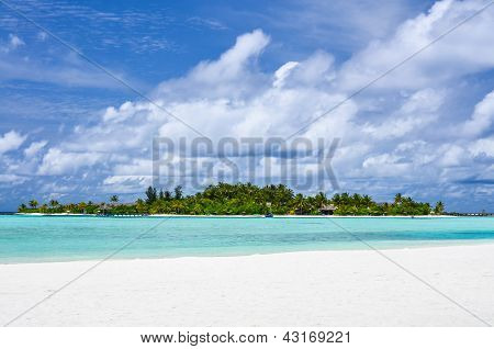 Island in the lagoon under a cloudy sky