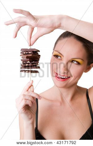 smiling brunette girl holding chocolate over white background