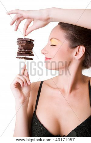 brunette smiling  sexy girl holding chocolate over white background