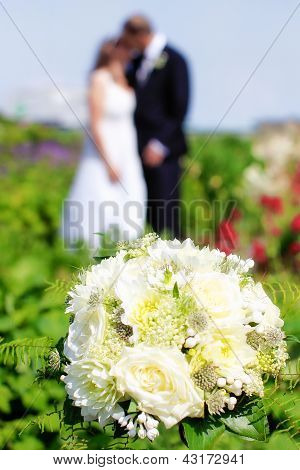 Wedding Bouquet And Newly Weds