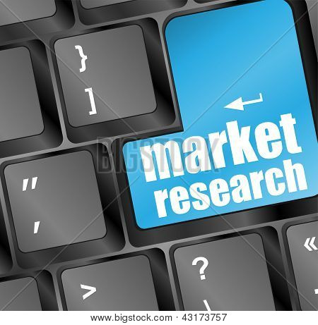 Blue Key With Market Research Text On Laptop Keyboard