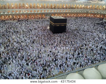 Kaaba Mecca in Saudi Arabia and Muslim pilgrims coming for Hajj (very rear images from inside the holy mosque)