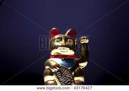 Maneki Neko Isolated On Magic Blue Background