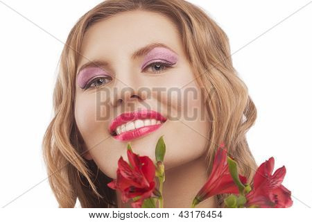 Happy Young Smiling Woman With Bunch Of Flowers