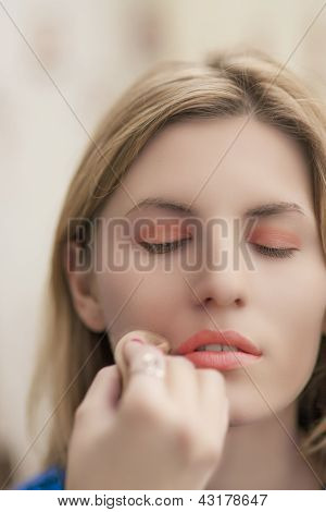 Young Blond Woman Is Being Applied Makeup