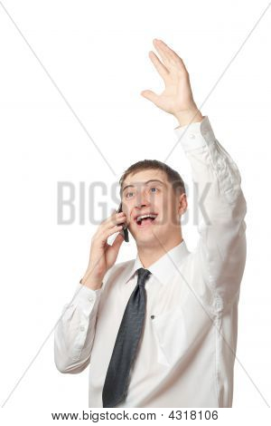 Happy Businessman Calling By Phone