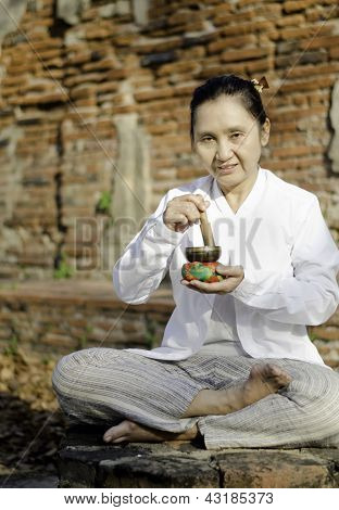 Woman Playing A Tibetan Bowl