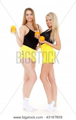 Young Women With  Oranges And Juice.
