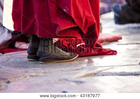 pilgrim praying at the jokhang temple in Lhasa, Tibet