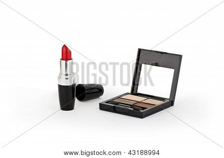 Red Lipstick, Powder And Comb
